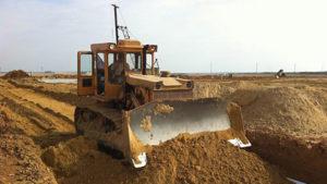 Земляные работы проводимые трактором